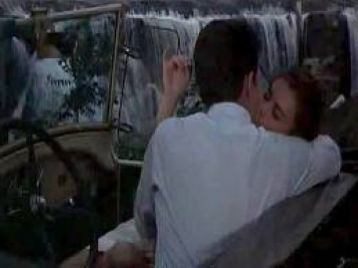 Bud and Deanie stealing kisses with the waterfalls in the drowning out sounds of sweet love words.