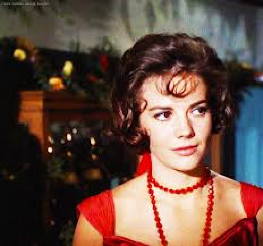 Deanie's heart is broken so she cuts her hair, puts on a red dress and goes to a party.