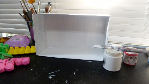 Painted shoe box ready for the design elements