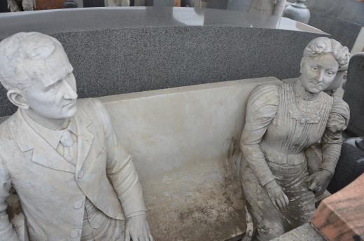 John Milburn Davis and wife, Sarah, sculpted as a young married couple.