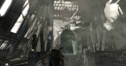 Tomb Raider smash the trapdoor by weakening the wooden beam and then allowing the bell to drop