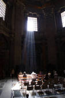 people praying in St. Peter's Basilic