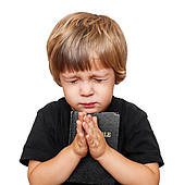 a brainwahed innocent child praying for what he does not understand