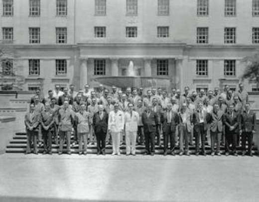 J. Edgar Hoover Posing with Special Agents Original caption: Photograph, taken July 17, 1939, during the annual conference of Special Agents in Charge and Officials of the Federal Bureau of Investigation with J. Edgar Hoover, Director of the FBI. Lef