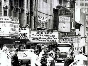 The 42nd street theaters still showed real movies, not porn, in 1975 when Kevin, myself, and some friends went to the above theater to see that Brannigan movie