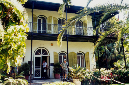 The entrance is to the Hemingway House, at 907 Whitehead Street, near the lighthouse in Key West. The writer Ernest Hemingway lived here from 1931 to 1939. He owned the house for some time afterward, and often visited it. The house was built in 1851.