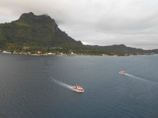 Tender boats transporting cruise passengers back from Bora Bora at the end of the day.
