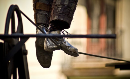 The feet of a tightrope walker