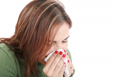She's sick with the flu, but she's going to suffer through it and report to work anyway.