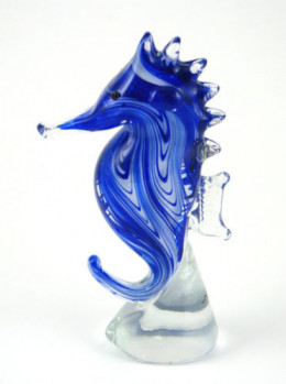 Murano glass sea horse in beautiful striations of blue ranging from royal blue to see blue to a small and elegant swirls of clear glass