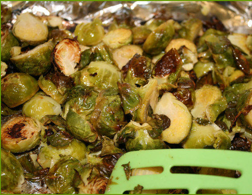 Baked Brussels Sprouts for a sweet nutty flavor using a a bit of olive oil and lemon and sea salt.  A healthy TASTY way of cooking them!