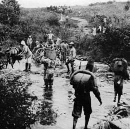 Belgian troops of the Force publique crossing a stream in what was then the Belgian Congo.  A long history of strife and exploitation has been suffered by this region.