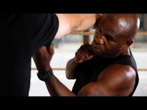 Iron Mike Tyson throws a left uppercut while training for a boxing match. His power was in his legs and the way he put all of his body into his shots.