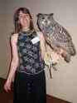 Girl with pet Eagle Owl