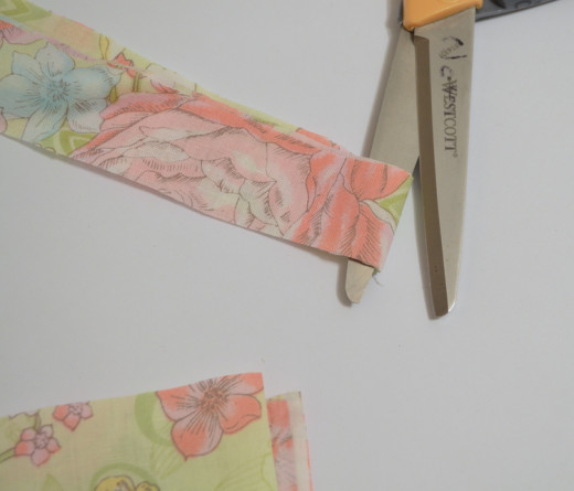 Cut strips along the folds - you will have one double thickness cut and one single thickness cut for each original strip.
