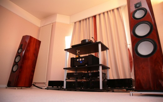 "A ""high-end' system in a specialist audio store - great sounding components few people can afford!  The trick is to get as close to the accuracy of such a system within the constraints of your budget."