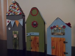 Handcrafted wooden houses with Stampin Up paper and accessories for whimsical theme