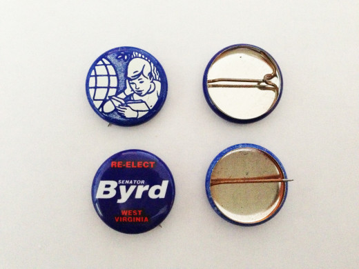 Examples of litho buttons, showing lock and straight pin attachments.