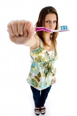 Brushing your teeth at least twice a day is the first step to maintaining good oral hygiene and curing bad breath.