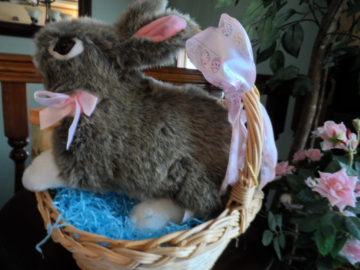 Children's toys like stuffed bunnies want to sit in an Easter basket