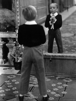 THE BOY ON THE MIRROR
