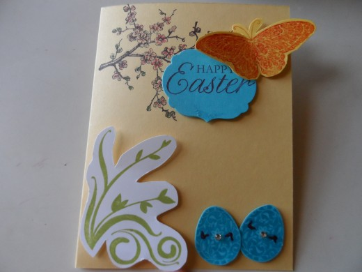Stampin Up handcrafted Easter greeting card with cherry blossoms, butterfly, and turquoise eggs.