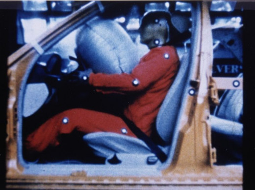 A Photo showing how seat belts work in tandem with  airbags