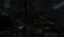 Tomb Raider shoot at the enemies from just beneath the rock cropping outside the wolf's cave