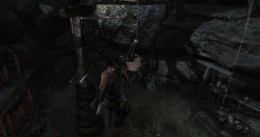 Tomb Raider use rope arrow to swing the deer carass away and then catch the bar as it swings into view. Then jump to the next ledge using the bar.