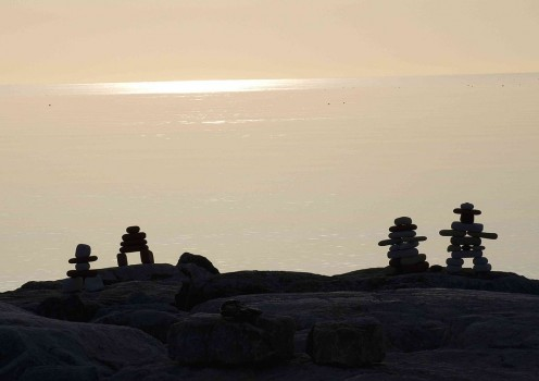 Phone: Stone inukshuks gaze out on a chilly sea.