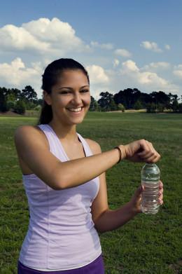 Exercising Girl Drinking Water