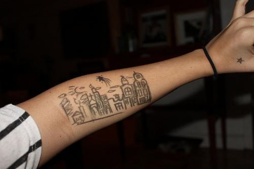 A cool sketched tattoo design of a city!