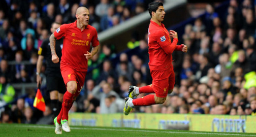 Suarez celebrating in front of Moyes