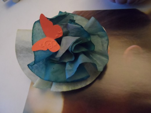 ink dyed coffee filter flowers and punch art butterfly. Can add to an Easter decoration or on a gift package.