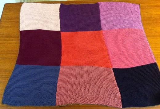 The completed blanket, with a thin single crochet border.