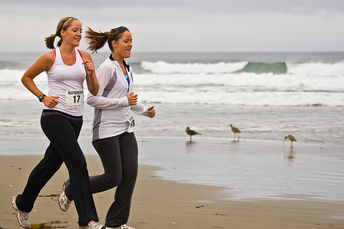 Running ladies on the beach.