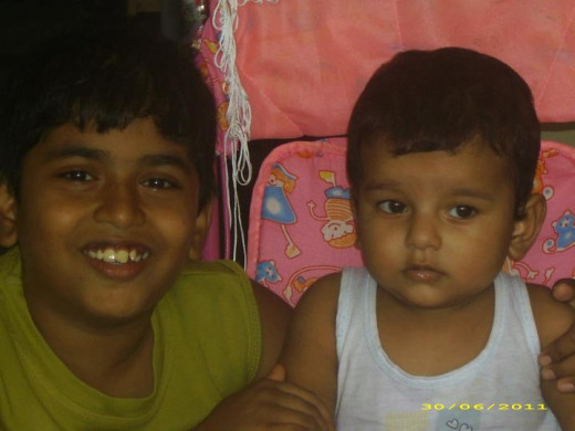 Atul Krishna, My Son & Motivator (The smiling boy) with his cousin Raj Vardhan, the youngest in our family.