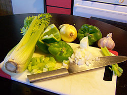 In Creole or Cajun Cooking the Holy Trinity is equal parts of Celery, Onions, And Green Bell Peppers.