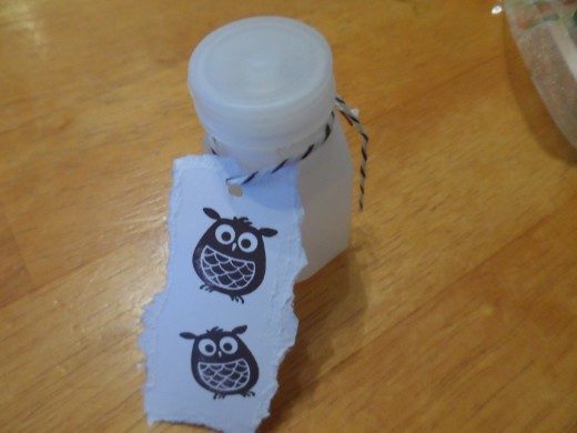 dollar store bubbles with hand stamped owls and colorful twine to dress it up and make it look cute.