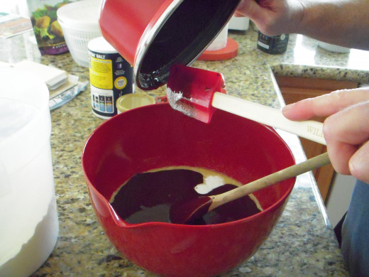 Add melted butter and chocolate mixture to the egg and sugar mixture and stir well.
