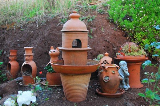 Terracotta garden ornaments add character to a quiet place