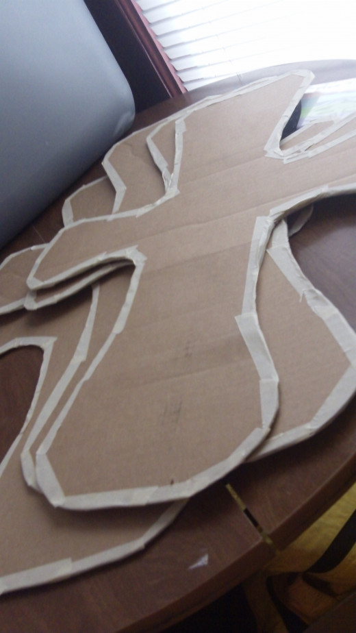 Trace shape on to cardboard, cut out four crosses.  Tape off edges with masking tape to smooth out.