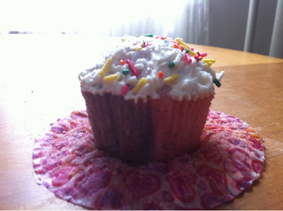 For a two tone effect have two people pour cupcake batter at the same time.