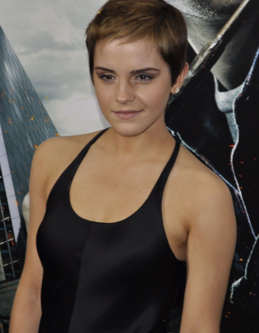 Emma Watson chooses a sleek, form-fitting dress to look feminine and stylish with her pixie cut.