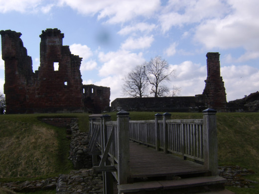 A wooden footbridge provides castle access over the one time moat of Penrith Castle