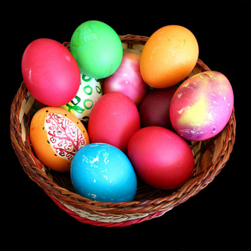 Easter eggs in a basket with the common colors of red and green.
