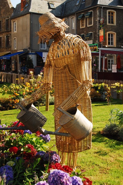 Creative weaving and watering the plants in a French City Garden