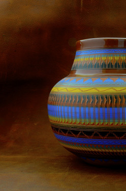 Native American pottery makes a colorful addition to a neutral desert room.