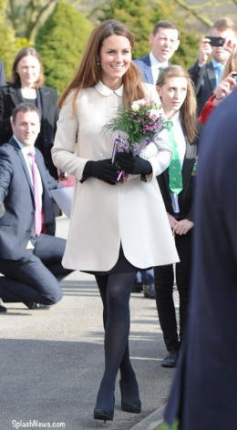 Kate greeting wellwishers in a cream coat from Goat