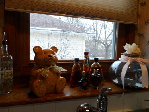 Cookie Jars and Glass containers add a lot of character and excitement to the window shelf